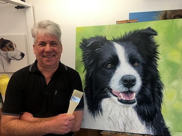 Nolan with a completed dog portrait commissioned painting