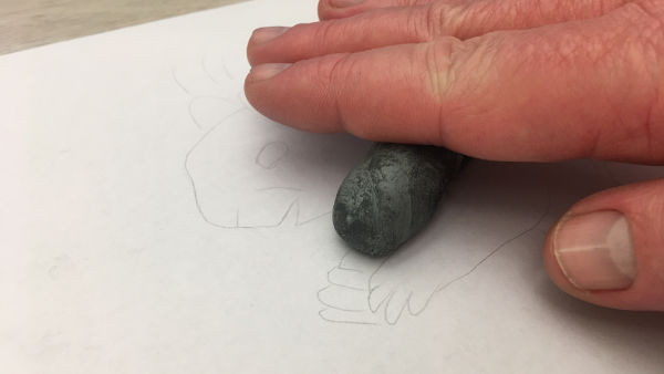 lighten sketch lines with kneaded eraser